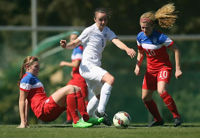 LA MANGA, SPAIN - MARCH 04: MiMi Asom (L) and Emily Ogle (R) of USA and Kasia Lipka (C) of England fight for the ball during the women's U23 international friendly match between USA U20 and England U23 on March 4, 2016 in La Manga, Spain. (Photo by Johannes Simon/Bongarts/Getty Images)