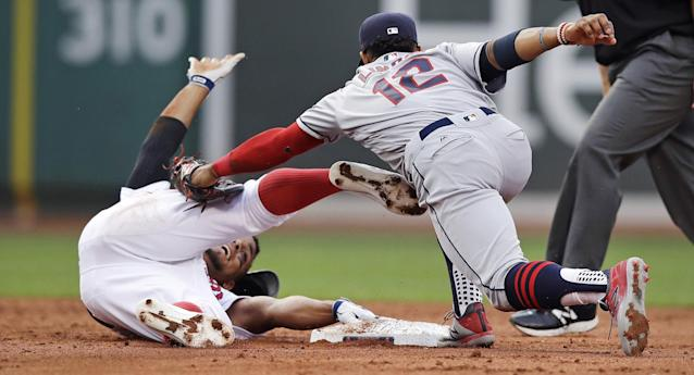 <p>Boston Red Sox's Xander Bogaerts, left, eludes the tag by Cleveland Indians shortstop Francisco Lindor (12) on his double during the second inning of a baseball game in Boston, Monday, Aug. 14, 2017. (AP Photo/Charles Krupa) </p>