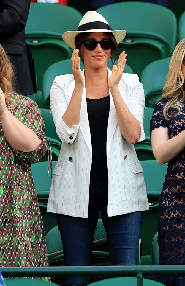 The Duchess of Sussex was spotted cheering on Serena Williams in a striped blazer by L'Agence. The new mother accessorised the look with Finlay & Co's 'Henrietta' sunglasses and her Madewell x Biltmore Panama hat. [Photo: Getty]