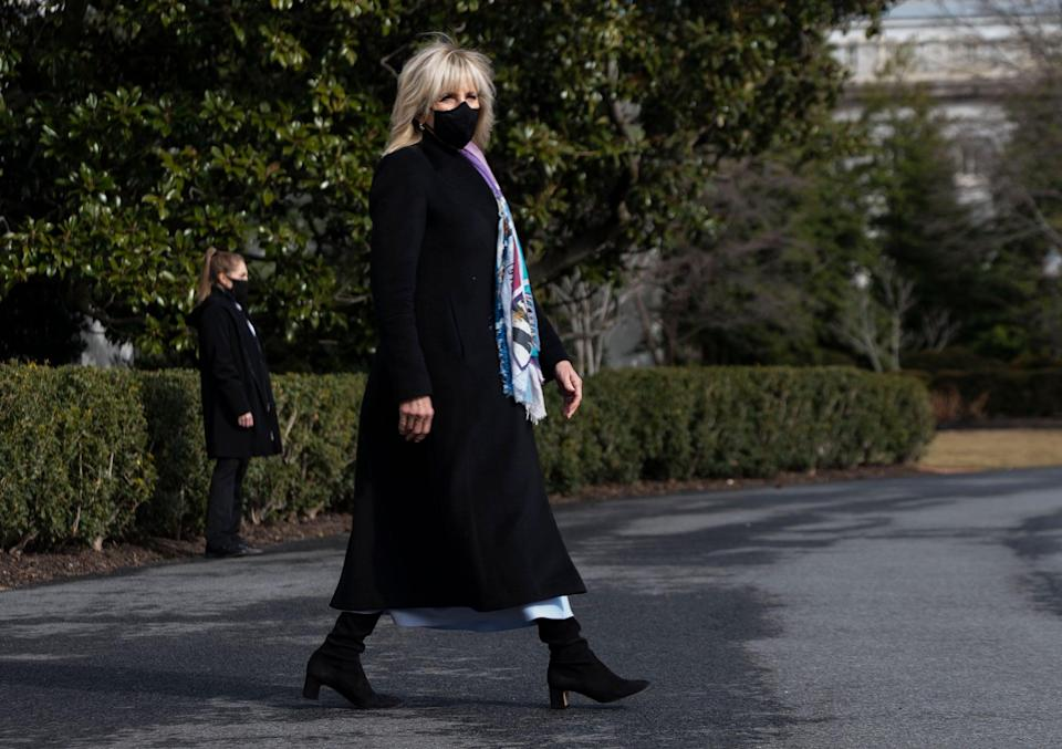 """<p>Biden covered her gray-blue Gabriela Hearst dress with a HiSO coat and accessorized with Stuart Weitzman boots and Mizuki jewels on the South Lawn of the White House in late February 2021. She has been a fan of sustainable brand Gabriela Hearst since before the election, having shown the <a href=""""https://www.popsugar.com/fashion/jill-biden-dress-presidential-debate-2020-47840642"""" class=""""link rapid-noclick-resp"""" rel=""""nofollow noopener"""" target=""""_blank"""" data-ylk=""""slk:power of recycling clothing"""">power of recycling clothing</a> for the first presidential debate while on the campaign trail, and then showing support for Hearst yet again in her <a href=""""https://www.popsugar.com/fashion/jill-biden-white-gabriela-hearst-dress-celebrating-america-48121001"""" class=""""link rapid-noclick-resp"""" rel=""""nofollow noopener"""" target=""""_blank"""" data-ylk=""""slk:white florals for Celebrating America"""">white florals for <b>Celebrating America</b></a>. Biden's moments in Gabriela Hearst so far have been a nod to protecting our environment, which the company is committed to doing through ethical practices.</p>"""