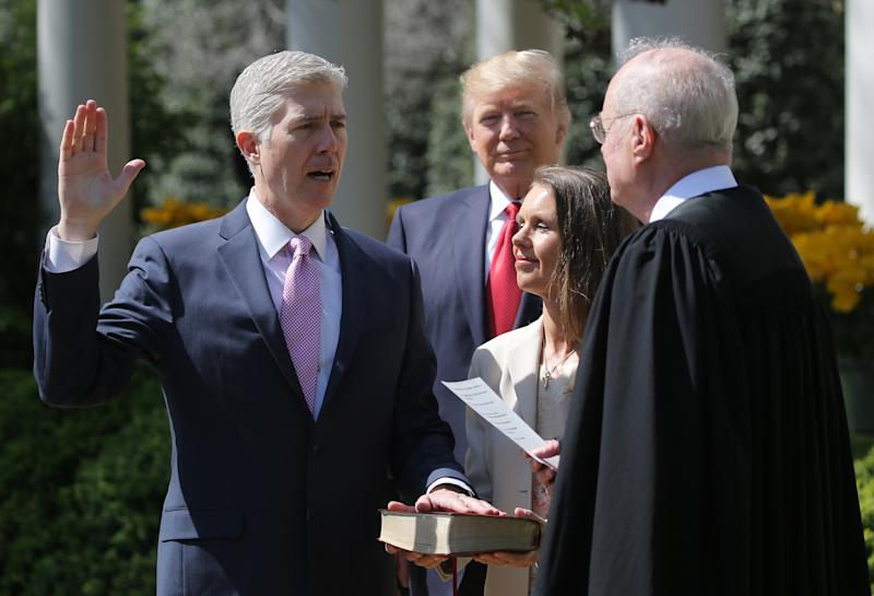 Supreme Court Justice Neil Gorsuch (left) is the demographic epitome of the Trump judge. (Carlos Barria / Reuters)