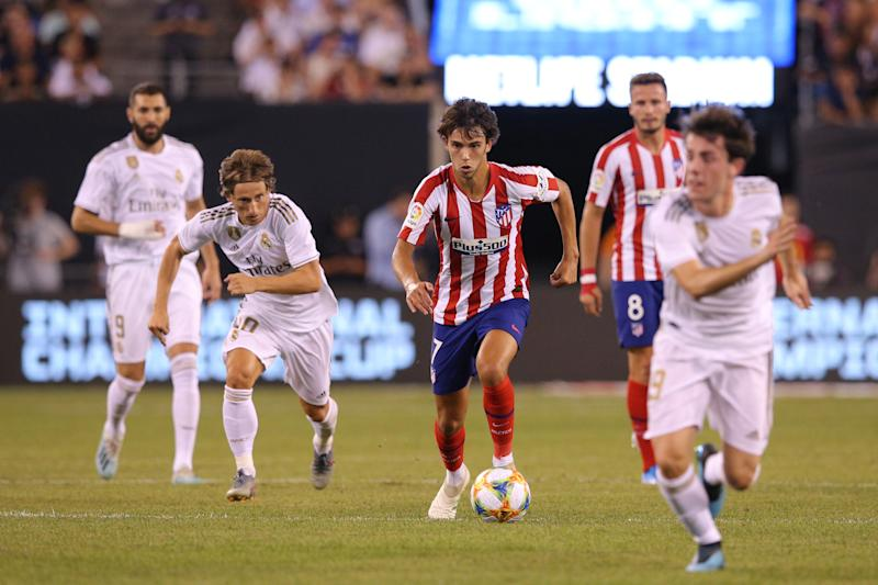 Jul 26, 2019; East Rutherford, NJ, USA; Atletico de Madrid forward Joao Felix (7) dribbles the ball against Real Madrid during the first half of an International Champions Cup soccer series match at MetLife Stadium. Mandatory Credit: Brad Penner-USA TODAY Sports
