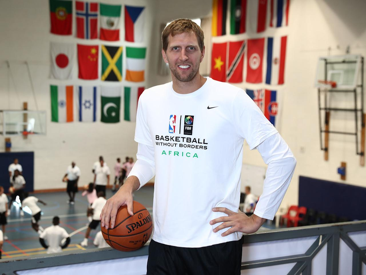 <p>Dirk Nowitzki's name has been synonymous with the Dallas Mavericks for 19 NBA seasons. Over the years, he's logged a lot of miles, playing deep into the postseason, committing to his national team and working hard to improve his craft in the summer.</p><p>In the latest Beyond the Baseline podcast with Jon Wertheim, Nowitzki talked a little tennis, looked back on his journey and discussed his preparation for year No. 20. </p><p></p><p><strong>Jon Wertheim: What is the offseason like for you both physically but also spiritually? What is the summer like, what is this off time like for a basketball player? </strong></p><p><strong>Dirk Nowitzki:</strong> We didn't make the playoffs last season unfortunately, so literally my last game was almost mid-April. The offseason is pretty long, we are very fortunate in basketball. I know the tennis guys have the shortest offseason ever. We have a few months.</p><p>When you're in your 20's you basically take a few weeks off and I was right back in the gym, I was working out in Germany, then I was playing national team every summer from year 20-30, so over 10 years basically every summer I played. And then once I turned 30 and got a little older, I didn't play for national team every summer anymore. That meant I had more time. We have three kids now so I get to spend a lot of time with them in the summer, we do travel a lot now since my wife and I are both from Europe, born and raised, so we go back home to Germany and Sweden, went to Africa this summer for a few weeks. Wifey has some ties there. </p><p>We were on the road for a good six or seven weeks and had a good time, and I'm trying to get back in it, which is harder as you get older. I turned 39 this summer and just working my way back the last two weeks hasn't been easy. I've been going hard six days a week the last three weeks, just trying to get back into game shape and get ready for camp.</p><p></p><p><strong>Wertheim: So 39 years old a generation ago, with the exception of Kareem, it's unheard of. In tennis it's the same. What do you think it is? Is it the technology? Is it the training? Is it the money that gives you incentive not to retire?</strong></p><p><strong>Nowitzki:</strong> It might be a complete package of all of that. I'm not sure they play for money, I'm sure they've made enough throughout their careers. I think it's some of the training, I think the knowledge we have now we didn't have 20 years ago. How much of a difference the training, the weight room, the stretching, the nutrition is a big part.</p><p>So I think that's a major part for sure and guys are able to compete for a longer time, and you see some of the older players in the NBA still able to play efficient. And obviously you're losing a step, but I think you're able to make it up by experience and just keeping your body sill in good shape, and you're able to play until your late 30's these days. I don't think it's anything abnormal anymore.</p><p><strong>Wertheim: Did you ever know your body better than you know it now?</strong></p><p><strong>Nowitzki:</strong> In your 20's you don't know anything. We used to have cheeseburgers before games and had no problems and went out there and played. And as you get older and older, I think you learn more about your body and say, 'Ok, this is not good. Too much sugar during the season hurts my feet.' Just little things that are crazy, so you're trying to just eat as clean as you can and listen to your body.</p><p>The last couple years I haven't really played back-to-backs. Last year for the first time I had an Achilles problem so I missed two months. It's unfortunate but it's something you deal with everyday, you get a routine, you do your stretching, you do your strengthening, you get some shots up and then you kind of see how you feel from day to day and make the decision. Is today the day we push? When should we pull back a little bit? And I'm sure it's the same with Roger and all these guys. It's constant conversation with your trainers and your weight coach to get ready for the next tournament in their case or the next game in our case.</p><p></p><p><strong>Wertheim: We were talking about how it's the same way you guys say listen, 'I might not play 82 games, I'll tell you that right now.' The same way Roger took off the clay season. If that's going to prolong Federer's career, if that's going to prolong your career…</strong></p><p><strong>Nowitzki:</strong> Yeah, I only played 82 maybe a couple times in my career early on. It's hard to be ready every night and I actually used to be proud of playing 82, but little things happen all the time, especially once you're older. We want to be a playoffs team, always have, so you don't wan to burn yourself out during the regular season. You want to go into the playoffs feeling pretty fresh. In Roger's case, it made sense. He played a fantastic season this year.</p>