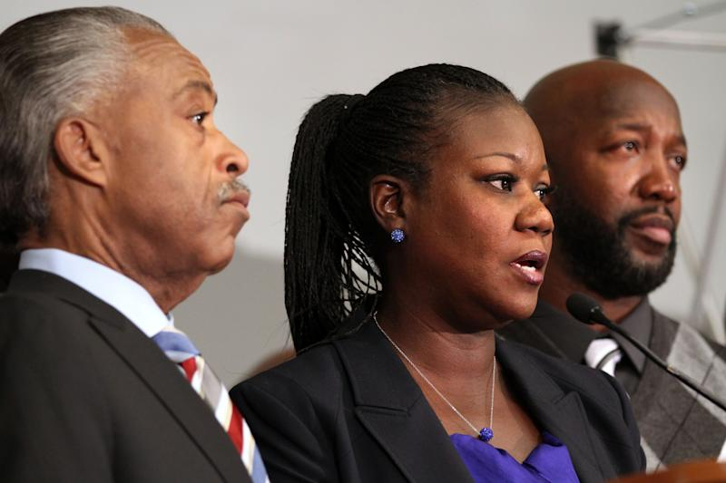 From left, Rev. Al Sharpton, Trayvon Martin's parents Sybrina Fulton and Tracy Martin, attend a news conference at the Washington Convention Center in Washington, Wednesday, April 11, 2012. (AP Photo/Jacquelyn Martin)