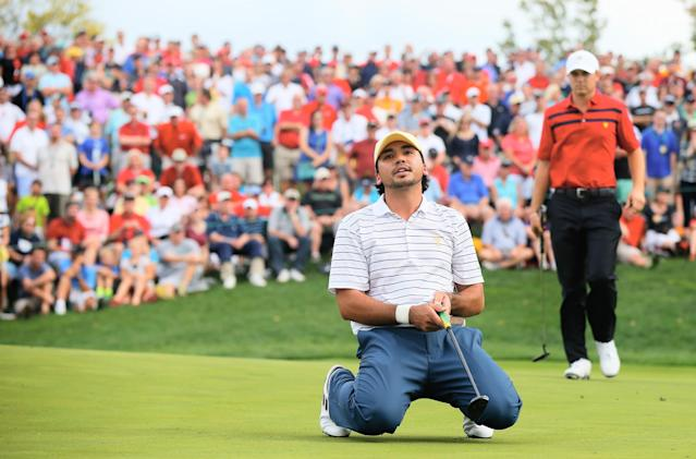 DUBLIN, OH - OCTOBER 05: Jason Day of Australia and the International Team reacts to a missed birdie putt on the 17th green as Jordan Spieth of the U.S. looks on during the Day Three Four-ball Matches at the Muirfield Village Golf Club on October 5, 2013 in Dublin, Ohio. (Photo by Matt Sullivan/Getty Images)