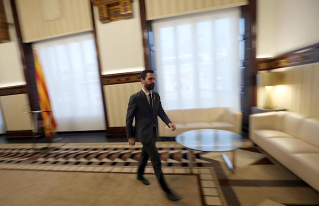Roger Torrent, Speaker of Catalan regional Parliament, leaves after he delivers a statement in Barcelona, Spain, March 21, 2018. REUTERS/Albert Gea