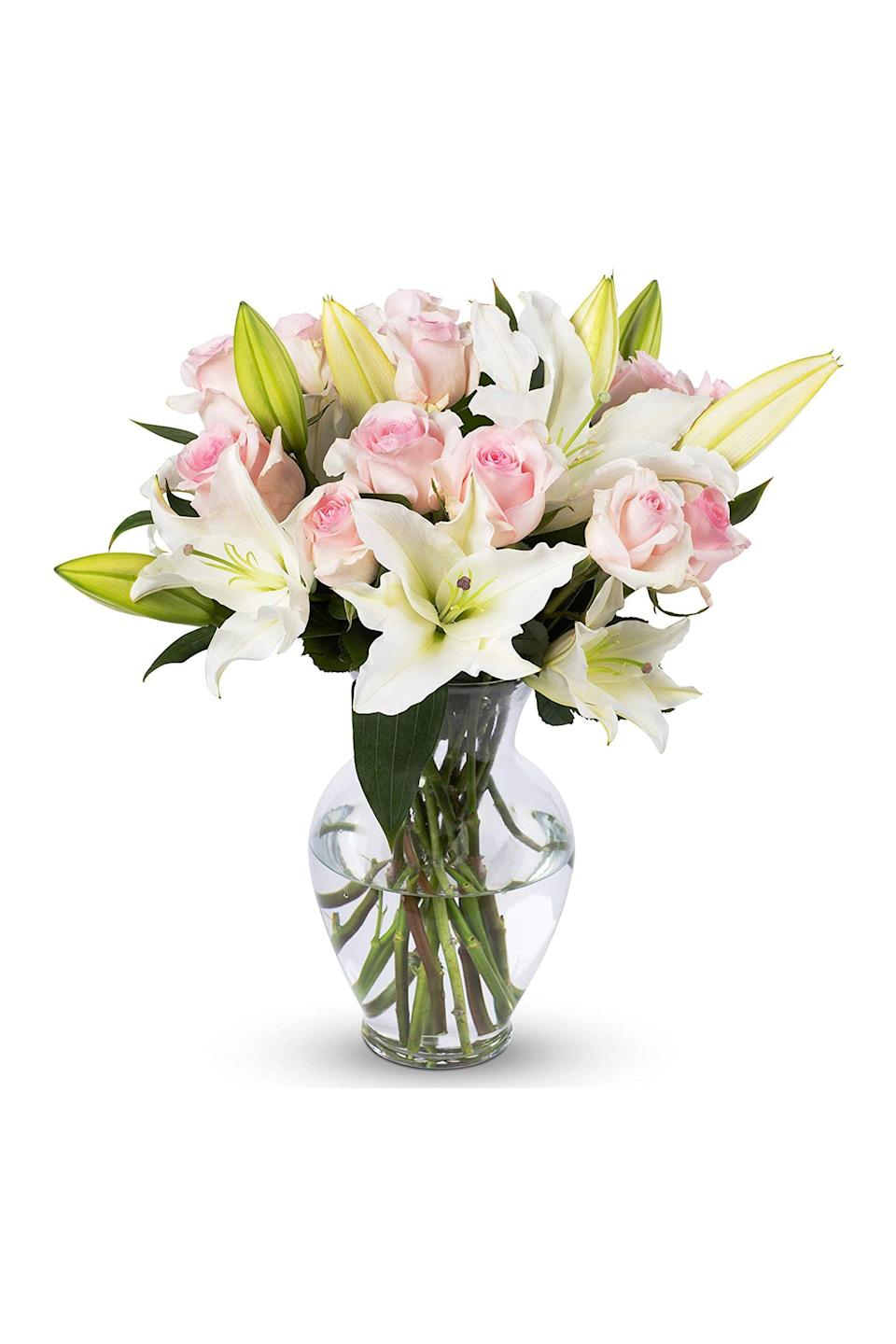 """<p><strong>Benchmark Bouquets</strong></p><p>amazon.com</p><p><a href=""""https://www.amazon.com/dp/B075V9B8SW?tag=syn-yahoo-20&ascsubtag=%5Bartid%7C10063.g.35152525%5Bsrc%7Cyahoo-us"""" rel=""""nofollow noopener"""" target=""""_blank"""" data-ylk=""""slk:Shop Now"""" class=""""link rapid-noclick-resp"""">Shop Now</a></p><p>Do all your shopping on Amazon? Add fresh flowers to your Prime cart, because the retailer's botanical selections just might surprise you. With raving reviews coupled with premium convenience, this is a no-brainer choice. </p>"""