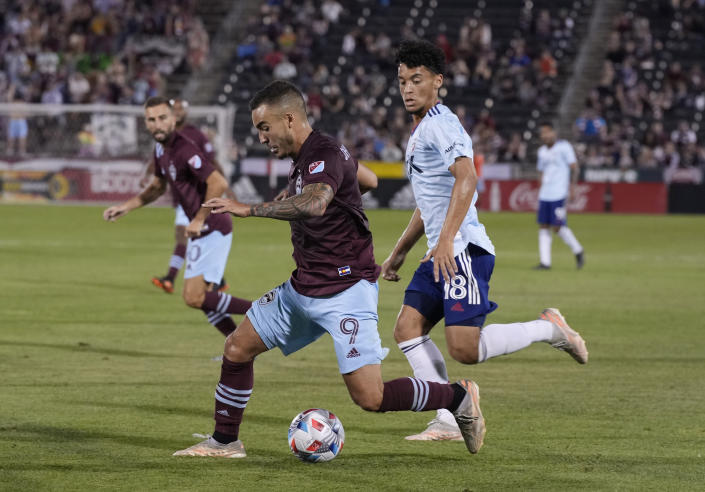 Colorado Rapids forward Andre Shinyashiki, left, moves the ball past FC Dallas midfielder Brandon Servania during the second half of an MLS soccer match Wednesday, July 21, 2021, in Commerce City, Colo. The Rapids won 2-0. (AP Photo/David Zalubowski)