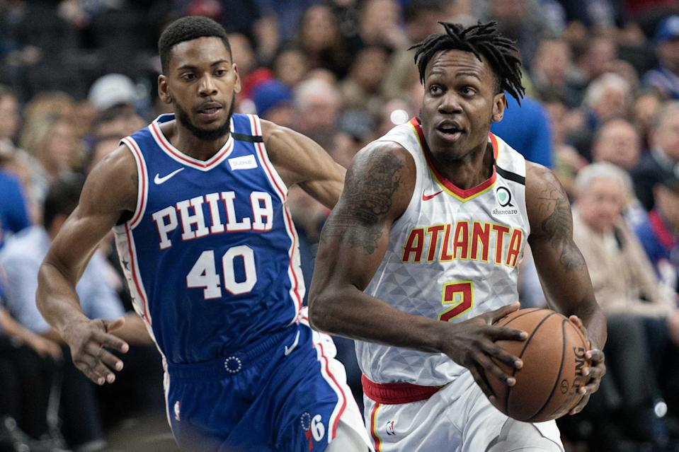 Feb 24, 2020; Philadelphia, Pennsylvania, USA; Atlanta Hawks guard Treveon Graham (2) drives against Philadelphia 76ers forward Glenn Robinson III (40) during the first quarter at Wells Fargo Center.