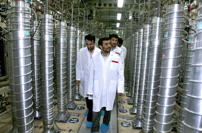 FILE -  In this April 8, 2008 file photo provided by the Iranian President's Office, Iranian President Mahmoud Ahmadinejad, center, visits the Natanz Uranium Enrichment Facility some 200 miles (322 kilometers) south of the capital Tehran. Iran has begun uranium enrichment at a new underground site well protected from possible airstrikes, a leading hardline newspaper reported Sunday, Jan. 8, 2011. (AP Photo/Iranian President's Office, File) NO SALES