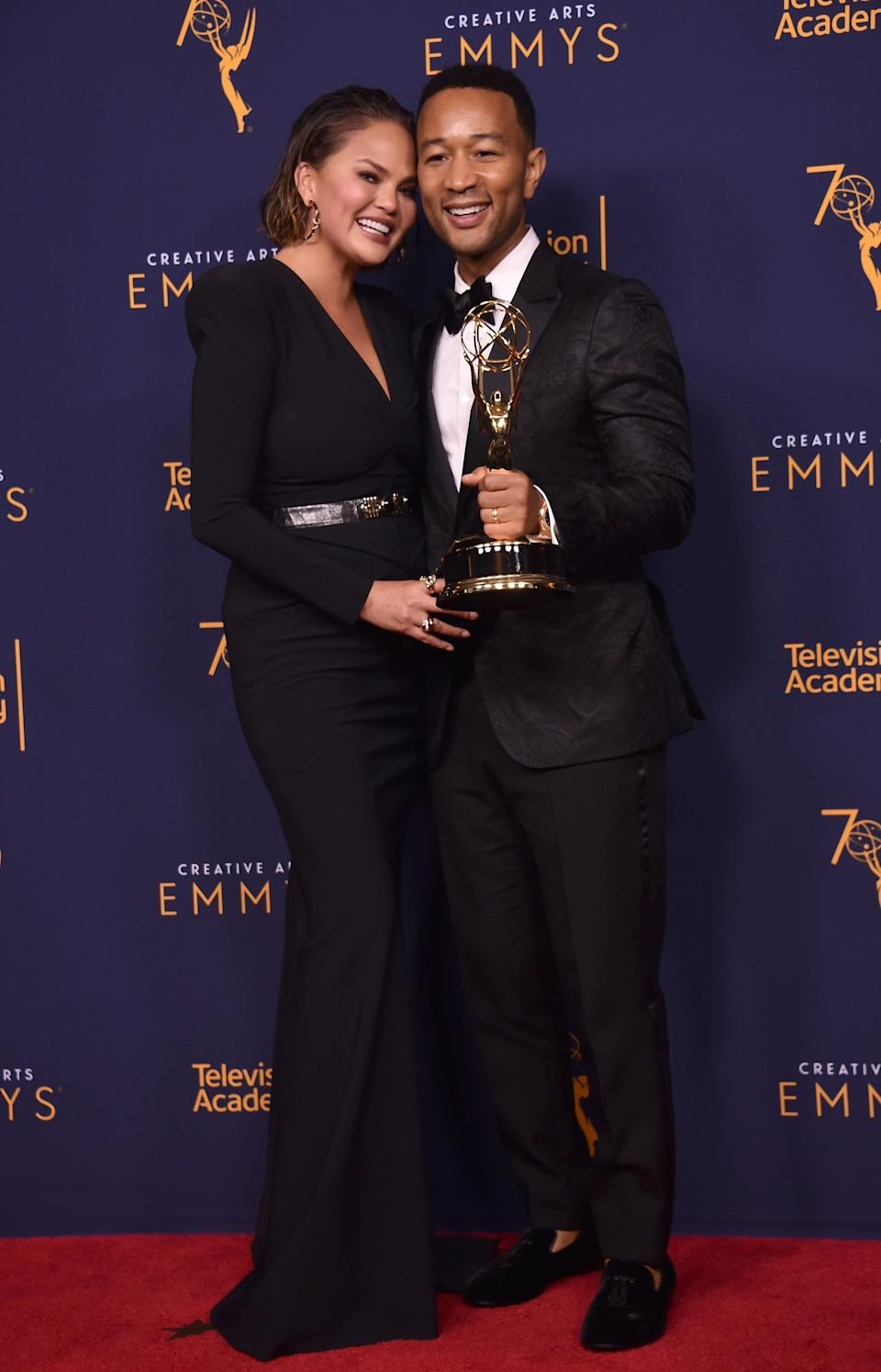 Chrissy Teigen and John Legend are one of the entertainment industry's most beloved couples. At the 2018 Emmys (as seen in this photo), they upped the cute factor with their coordinated ensembles, which perfectly complemented Legend's golden statue.