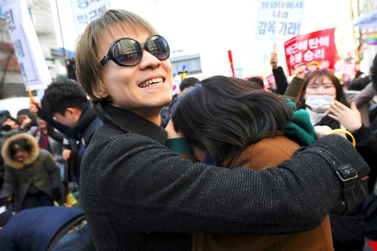 Anti-government activists celebrate the dismissal of South Korean President Park Geun-Hye, March 10, 2017