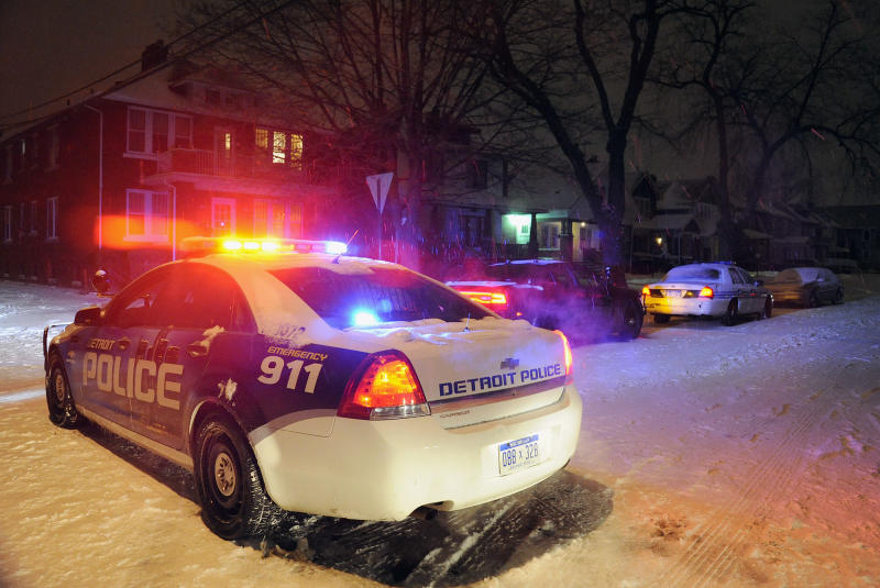 A Detroit Police vehicle is parked in the neighborhood where a four year old boy was shot with a rifle on Thursday, Jan. 16, 2014 in Detroit. A 4-year-old girl accidentally shot her 4-year-old cousin to death with a loaded rifle that she found under a bed at their grandfather's Detroit home, police said Friday. The girl was playing and watching TV on Thursday afternoon with the 4-year-old boy and his 5-year-old sister when she found the gun, police Sgt. Michael Woody said. He said she picked up the weapon, pointed it at the boy and shot him once in the chest. (AP Photo/Detroit News, Jose Juarez) DETROIT FREE PRESS OUT; HUFFINGTON POST OUT