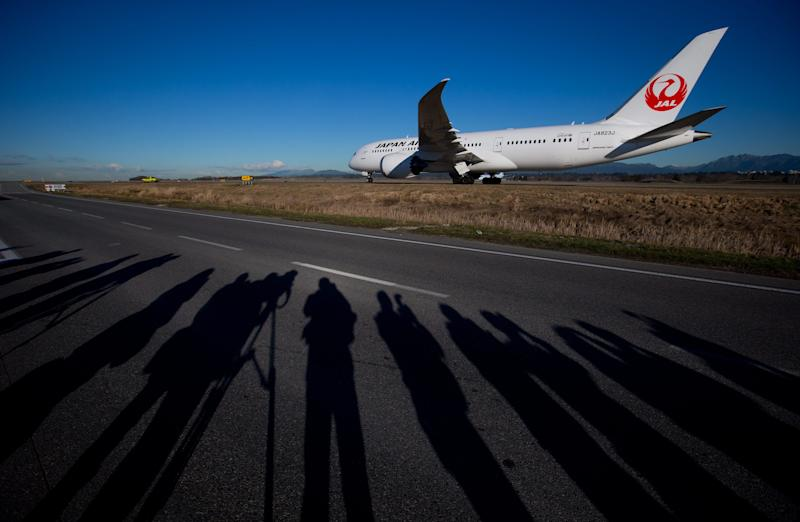 A Japan Airlines Boeing 787-800 Dreamliner taxis to a gate after arriving at Vancouver International Airport in Richmond, B.C., on Monday Feb. 3, 2014, marking the first time the aircraft has landed at the airport. The Boeing 787 will be used by Japan Airlines on the existing Tokyo Narita-Vancouver route once a week and will be phased into the regular daily service currently being flown by a Boeing 767 beginning March 30. (AP Photo/The Canadian Press, Darryl Dyck)