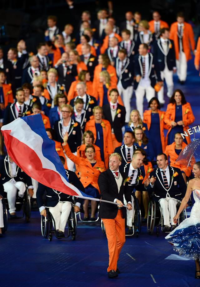 LONDON, ENGLAND - AUGUST 29: Athlete Ronald Hertog of Netherlands carries the flag during the Opening Ceremony of the London 2012 Paralympics at the Olympic Stadium on August 29, 2012 in London, England. (Photo by Gareth Copley/Getty Images)