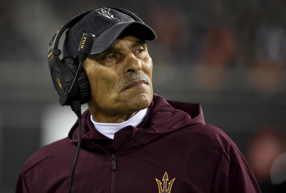 "File-This Nov. 16, 2019, file photo shows Arizona State coach Herm Edwards watching from the sideline during the second half of the team's NCAA college football game against Oregon State in Corvallis, Ore. In 2003, the NFL had three minority head coaches: future Pro Football Hall of Famer Tony Dungy, Edwards and Marvin Lewis. In the 12 previous seasons, there had been six. Total. Considering that the majority of the players in the league 16 years ago were minorities, that imbalance was enormous. And disturbing. And, frankly, it was unfair. Paul Tagliabue, then the NFL commissioner, put together a committee that established the ""Rooney Rule,"" which requires all teams with coaching and front office vacancies to interview minority candidates. The rule, long overdue, was named for Dan Rooney, then president of the Pittsburgh Steelers and the overseer of that committee.  (AP Photo/Steve Dykes, File)"