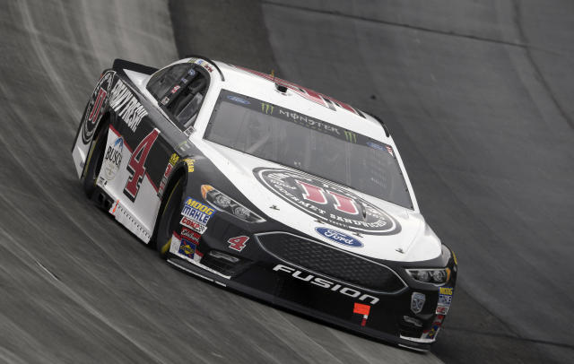 "<a class=""link rapid-noclick-resp"" href=""/nascar/sprint/drivers/205/"" data-ylk=""slk:Kevin Harvick"">Kevin Harvick</a> competes during the NASCAR Cup Series auto race, Sunday, May 6, 2018, at Dover International Speedway in Dover, Del. (AP Photo/Nick Wass)"