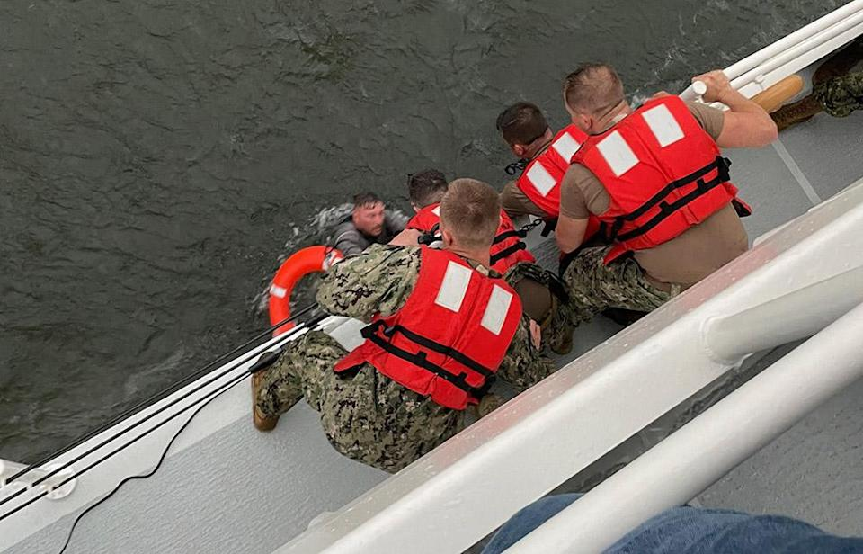 Image: The crew of the Coast Guard Cutter Glenn Harris pull a person from the water (U.S. Coast Guard / AFP - Getty Images)
