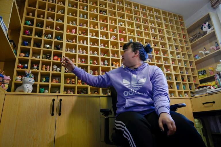 Music student Wang Zhaoxue shows her collection of 'blind box' toys