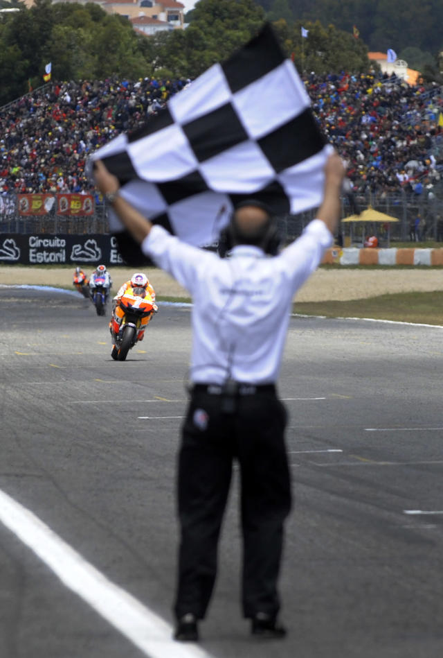 Repsol Honda team's Australian Casey Stoner crosses the finish line to win the Moto GP race of the Portuguese Grand Prix in Estoril, outskirts of Lisbon, on May 6, 2012. Stoner won the race ahead Spanish Jorge Lorenzo and Dani Pedrosa. AFP PHOTO / MIGUEL RIOPAMIGUEL RIOPA/AFP/GettyImages