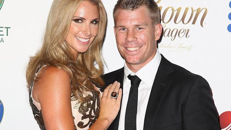 Warner pictured with wife Candice. Pic: Getty