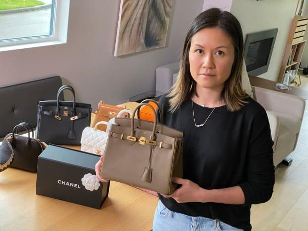 Angel Pui sold a designer handbag for $1,600. The money sat in her account for a month before Tangerine reversed the payment — and won't tell her why.  (Mike Zimmer/CBC - image credit)