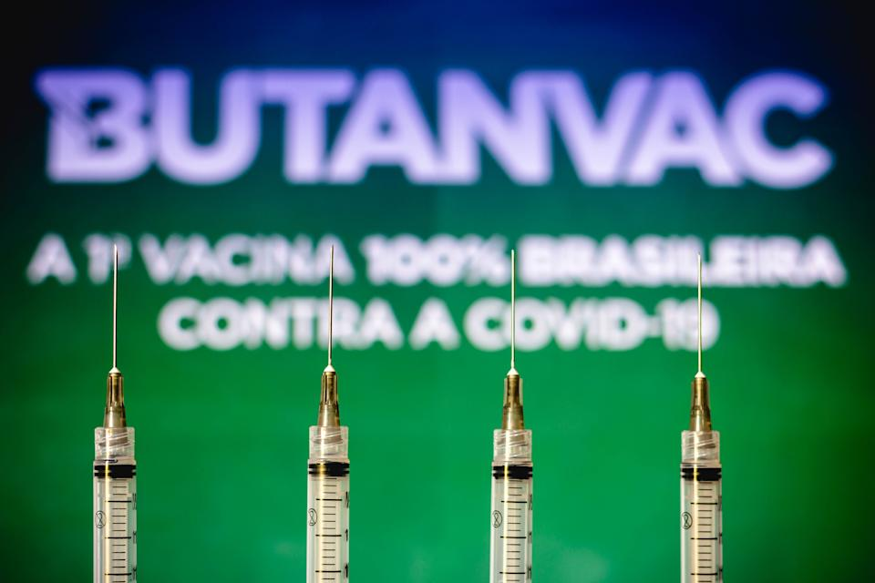 BRAZIL - 2021/03/26: In this photo illustration medical syringes are seen with Butanvac logo displayed in the background.  The vaccine from the Butantan Institute is being developed in Brazil. (Photo Illustration by Rafael Henrique/SOPA Images/LightRocket via Getty Images)