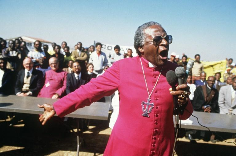 July 10, 1985: Tutu speaking at the funerals of four young anti-apartheid activists killed by hand grenades (AFP/GIDEON MENDEL)