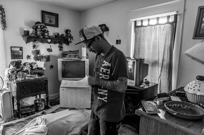 """<p>Larry Fugate, a recovering heroin addict at home in Middletown, writes music: """"Blues Clues couldn't solve this — mystery. Cocaine, amphetamine, codeine dreams — a fiend."""" (Photograph by Mary F. Calvert for Yahoo News) </p>"""