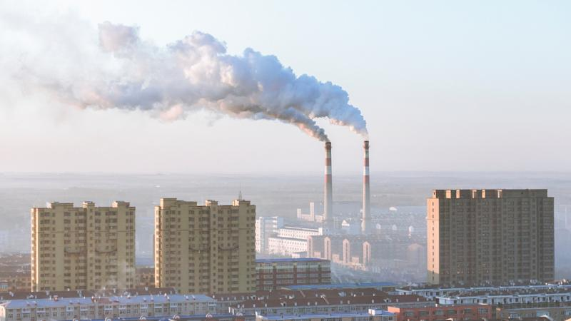 Coal power stations outputting smoke into the air.