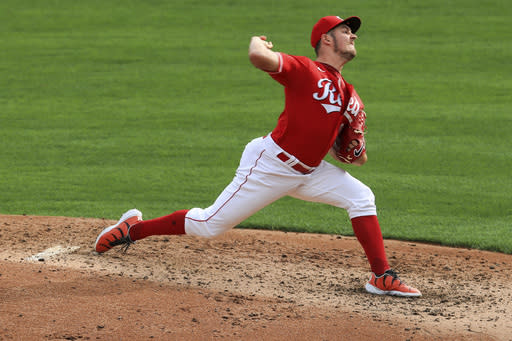 Cincinnati Reds' Trevor Bauer throws in the fourth inning during a baseball game against the Pittsburgh Pirates in Cincinnati, Monday, Sept. 14, 2020. (AP Photo/Aaron Doster)