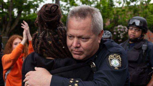 PHOTO: Bellevue Police Chief Steve Mylett hugs a demonstrator during a gathering to protest the recent death of George Floyd on May 31, 2020 in Bellevue, Washington.  (David Ryder/Getty Images)
