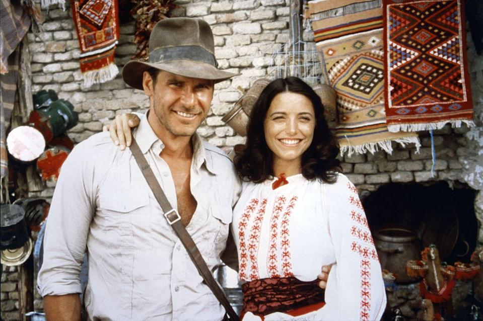 <p>Harrison Ford and Karen Allen on the set of <em>Raiders of the Lost Ark</em> in 1981.</p>
