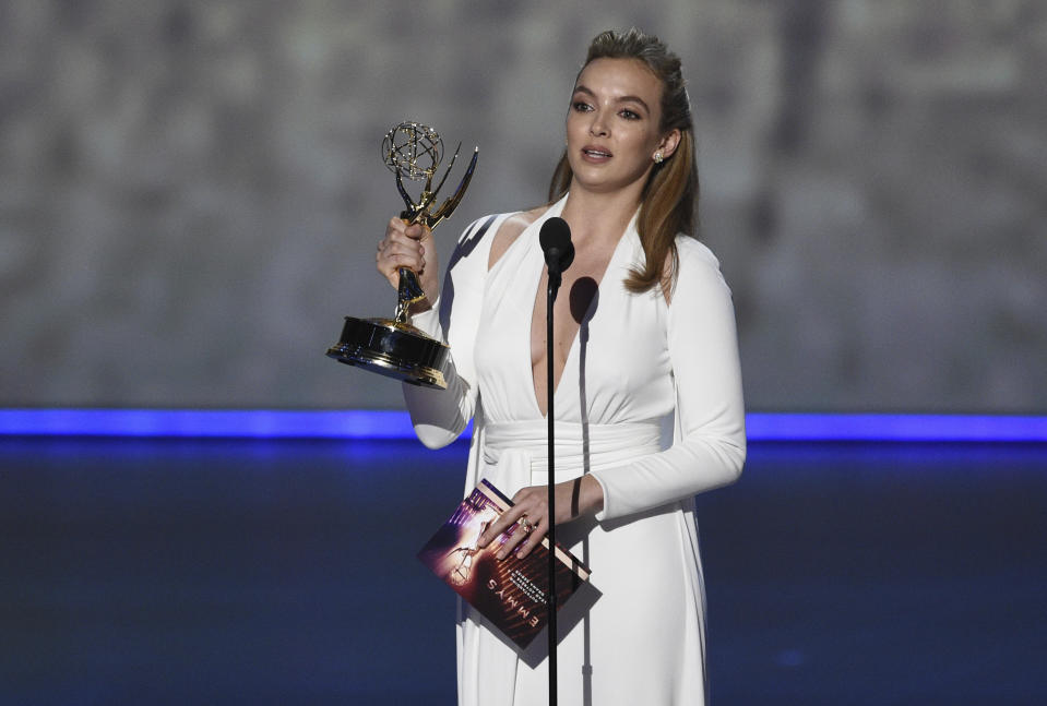 """Jodie Comer accepts the award for outstanding lead actress in a drama series for """"Killing Eve"""" at the 71st Primetime Emmy Awards on Sunday, Sept. 22, 2019, at the Microsoft Theater in Los Angeles. (Photo by Chris Pizzello/Invision/AP)"""