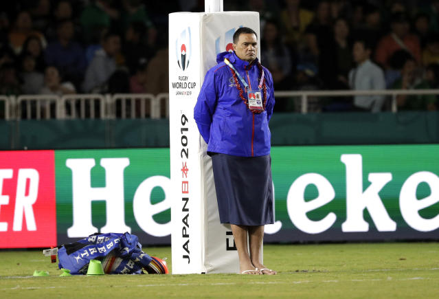 Samoafs coach Samoa coach Steve Jackson watches his players warm up ahead of the Rugby World Cup Pool A game at Fukuoka Hakatanomori Stadium between Ireland and Samoa, in Fukuoka, Japan, Saturday, Oct. 12, 2019. (AP Photo/Aaron Favila)
