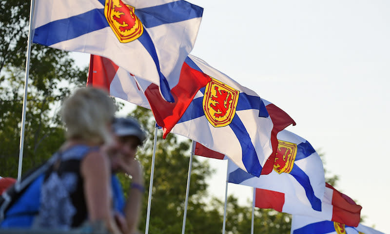 Flags of Nova Scotia and Canada. Photo from Getty Images.