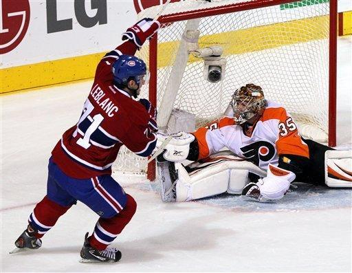 Montreal Canadiens center Louis Leblanc (71) scores the first goal of his career against Philadelphia Flyers goalie Sergei Bobrovsky (35) during second-period NHL hockey game action on Thursday, Dec. 15, 2011, in Montreal. (AP Photo/The Canadian Press, Ryan Remiorz)