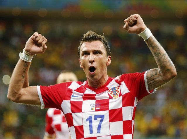Croatia's Mario Mandzukic celebrates after scoring a goal during their 2014 World Cup Group A soccer match against Cameroon at the Amazonia arena in Manaus June 18, 2014. REUTERS/Siphiwe Sibeko (BRAZIL - Tags: SOCCER SPORT WORLD CUP)