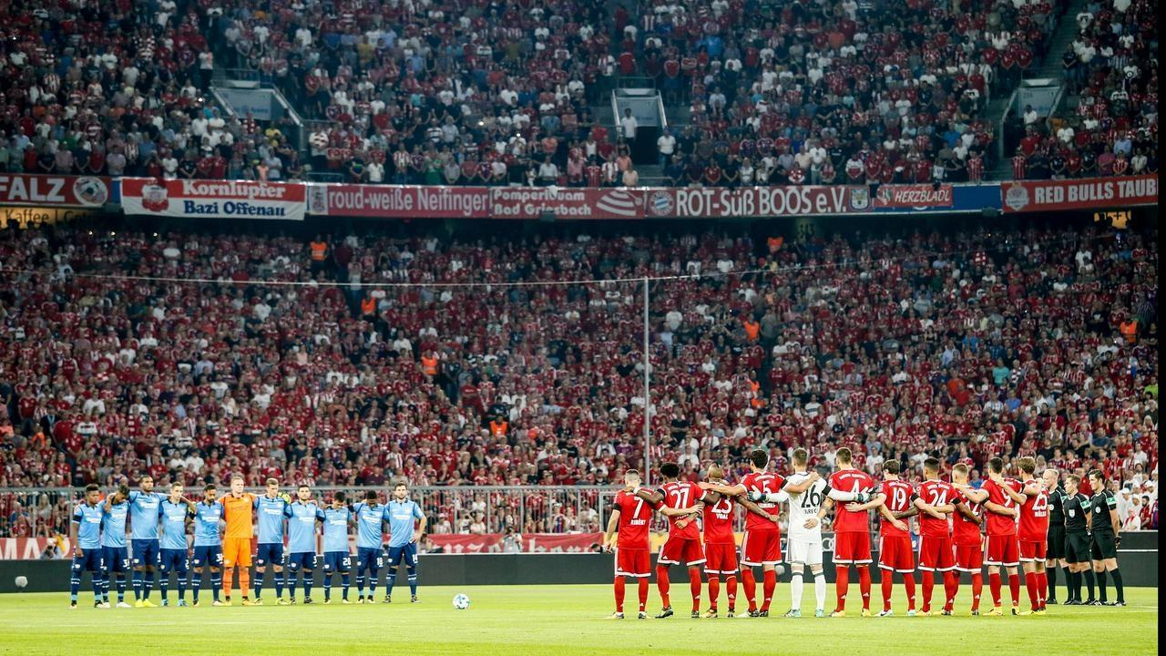 Bayern Munich and Bayer Leverkusen players and fans pay tribute the Barcelona victims on Friday.