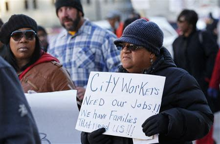 Detroit city worker Geraldine Gilmore (R) rallies against cuts in their city pensions and health care benefits during a protest against the city's municipal bankruptcy filing, outside the Federal courthouse in Detroit, Michigan October 23, 2013. REUTERS/Rebecca Cook