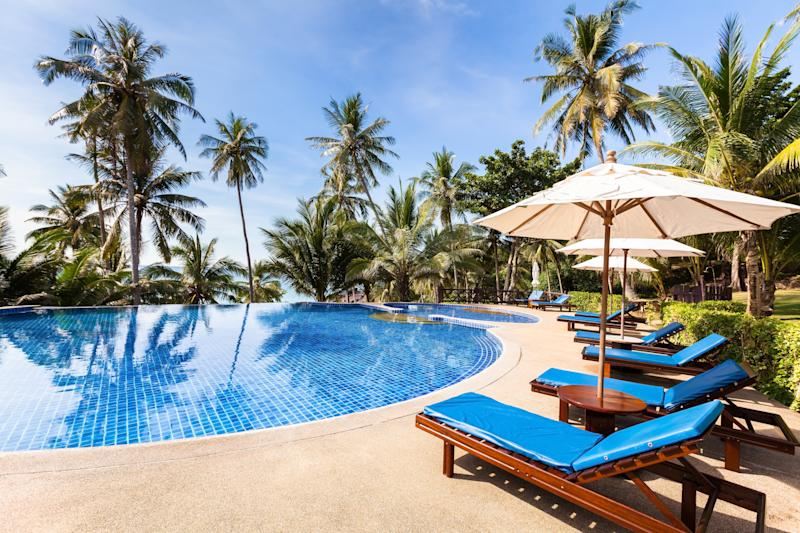 Pictured is a pool and palm trees at the Thailand resort.