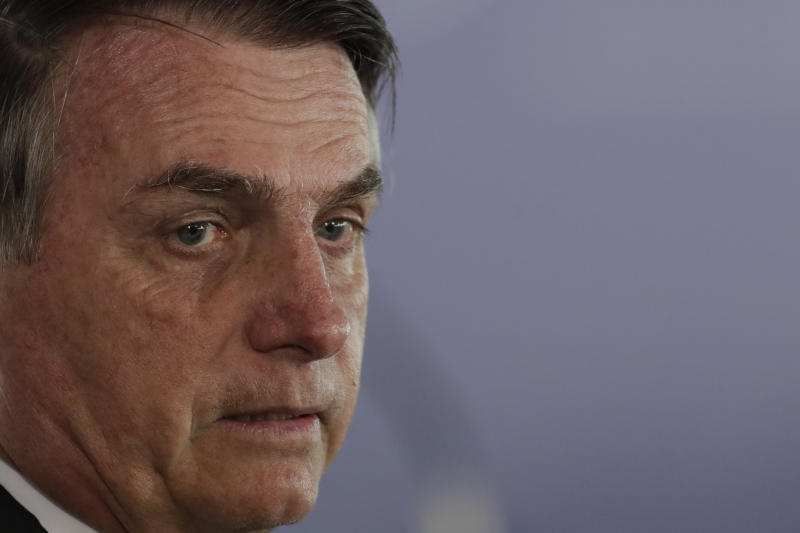 """FILE - In this Aug. 15, 2019 file photo, Brazil's President Jair Bolsonaro attends a merit medal decoration ceremony, in Brasilia, Brazil. Bolsonaro said this that with a new law he backs, criminals """"are going to die in the street like cockroaches."""" (AP Photo/Eraldo Peres)"""