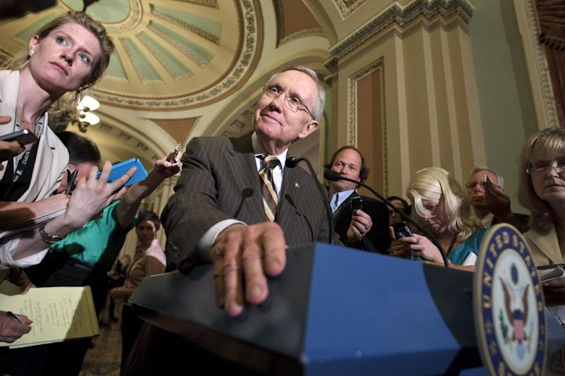 Senate Majority Leader Harry Reid of Nev., announces to reporters on Capitol Hill in Washington, Tuesday, July 31, 2012, that he and GOP House Speaker John Boehner have reached an agreement to keep the government running on autopilot for six months when the current budget year ends on Sept. 30. (AP Photo/J. Scott Applewhite)