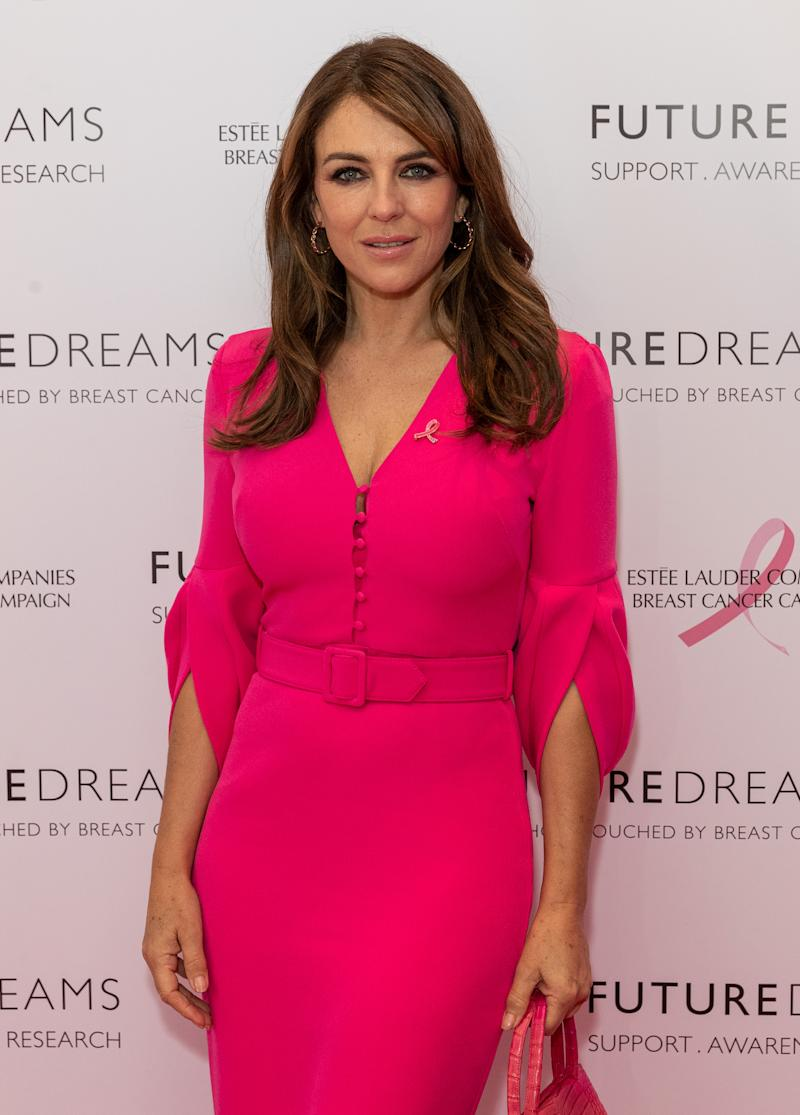 A photo of Elizabeth Hurley wearing a pink dress at the Future Dreams Ladies Lunch 2019 supported by Estee Lauder at The Savoy Hotel on October 7, 2019 in London, England.