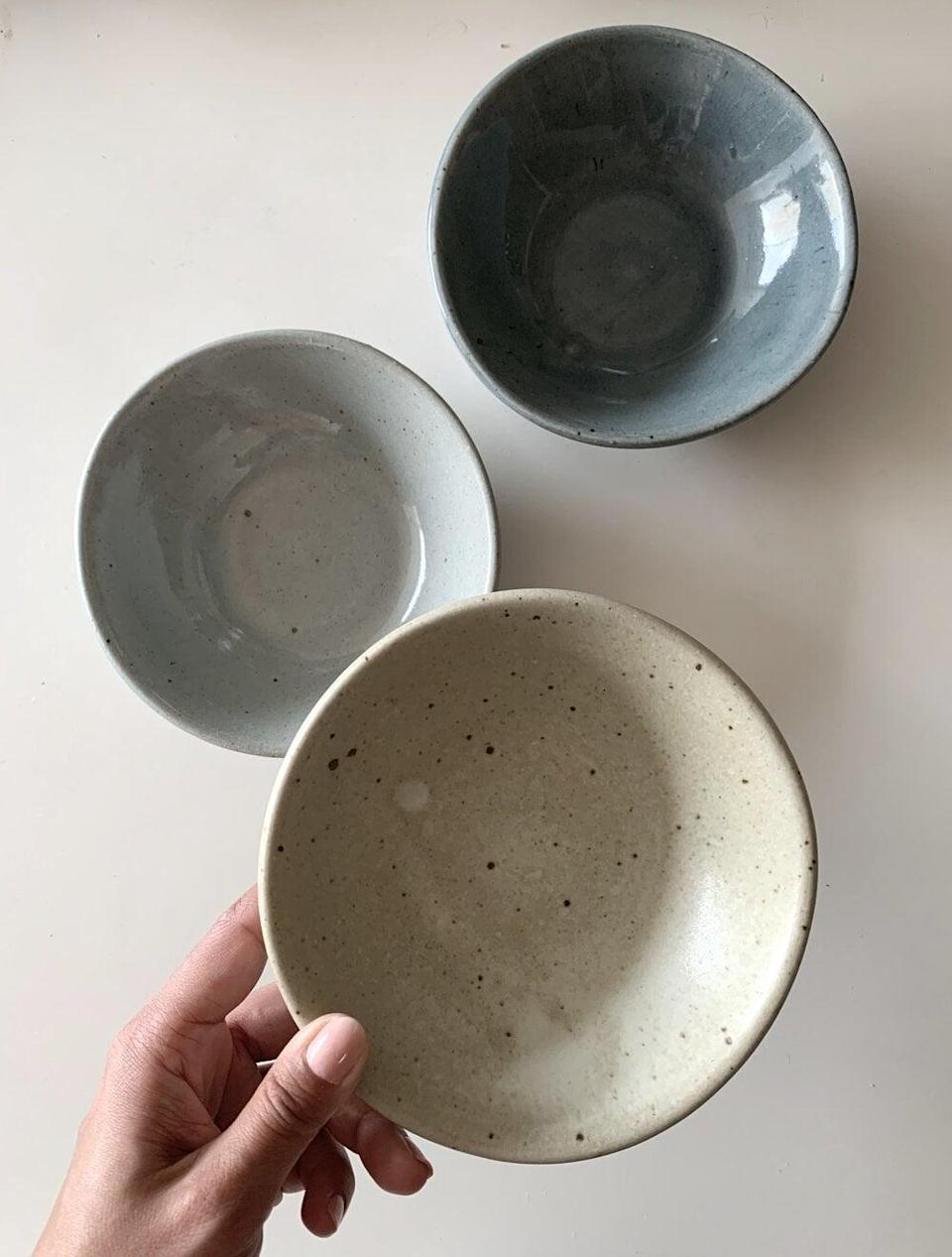 """<p>Upgrade your kitchen with a few of these <a href=""""https://www.popsugar.com/buy/Home-Obidos-Mini-Bowls-584965?p_name=Home%20by%20BE.%20Obidos%20Mini%20Bowls&retailer=homebybe.com&pid=584965&price=40&evar1=casa%3Aus&evar9=45784601&evar98=https%3A%2F%2Fwww.popsugar.com%2Fhome%2Fphoto-gallery%2F45784601%2Fimage%2F47575729%2FHome-by-BE-Obidos-Mini-Bowl&list1=shopping%2Cproducts%20under%20%2450%2Cdecor%20inspiration%2Caffordable%20shopping%2Chome%20shopping&prop13=api&pdata=1"""" class=""""link rapid-noclick-resp"""" rel=""""nofollow noopener"""" target=""""_blank"""" data-ylk=""""slk:Home by BE. Obidos Mini Bowls"""">Home by BE. Obidos Mini Bowls</a> ($40).</p>"""