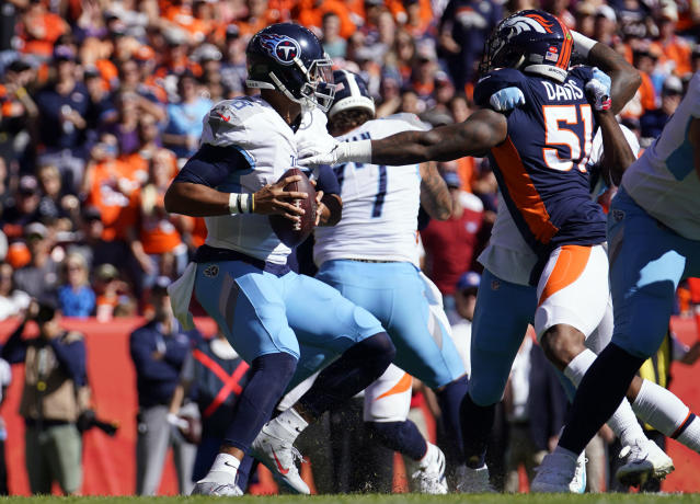 Denver Broncos inside linebacker Todd Davis, right, gets a hand on Tennessee Titans quarterback Marcus Mariota, left, during the first half of an NFL football game Sunday, Oct. 13, 2019, in Denver. (AP Photo/Jack Dempsey)