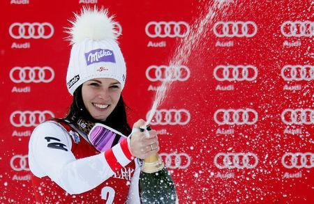 Alpine Skiing - Women's Alpine Skiing World Cup Super G - Val d´Isere, France - December 17, 2017 Austria's Anna Veith sprays champagne as she celebrates winning the Women's Super G REUTERS/Robert Pratta