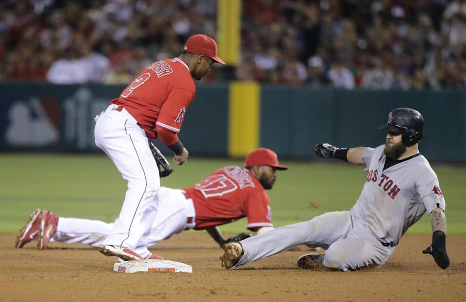 Los Angeles Angels second baseman Howie Kendrick, background center, grabs the ball as Boston Red Sox's Mike Napoli, right, safely takes second base against Angels shortstop Erick Aybar during the seventh inning of a baseball game on Saturday, Aug. 9, 2014, in Anaheim, Calif. (AP Photo/Jae C. Hong)