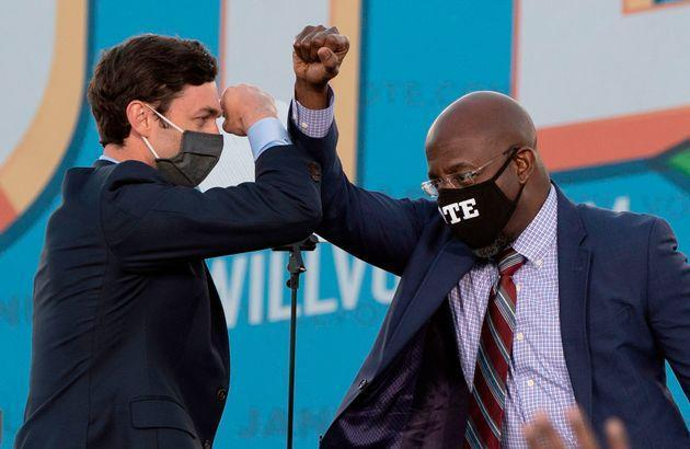 Victories in a pair of runoff elections in January made Jon Ossoff (left) the first Jewish U.S. senator ever elected in Georgia and the Rev. Raphael Warnock the first Black senator in the state's history. (Photo: JIM WATSON via Getty Images)