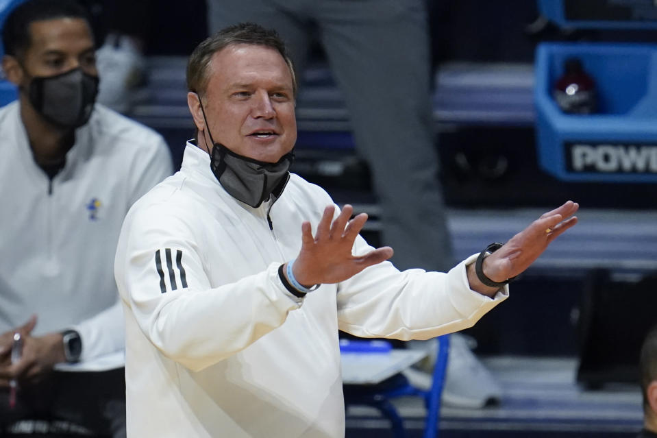 Kansas head coach Bill Self signals against USC during the first half of a men's college basketball game in the second round of the NCAA tournament at Hinkle Fieldhouse in Indianapolis, Monday, March 22, 2021. (AP Photo/Paul Sancya)